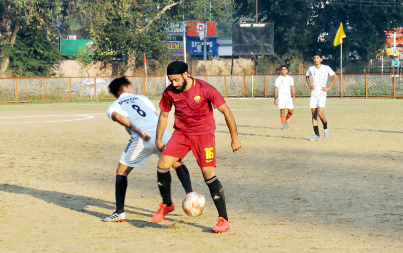 Footballers in action during a match of 13th Christmas Gold Cup Football Tournament in Jammu. — Excelsior/Rakesh