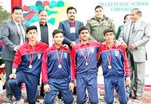 Winners posing along with dignitaries and officials during Annual Sports Day celebration at DPS Udhampur.