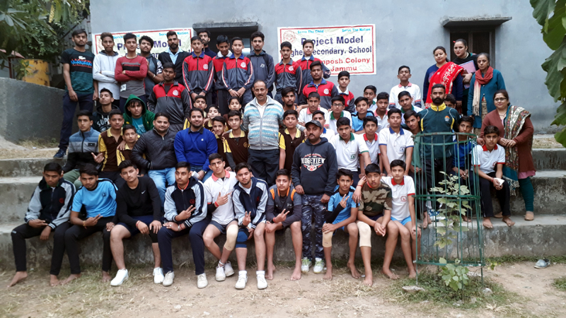 Young Kabaddi players posing along with dignitaries and officials at Project Model School in Jammu.