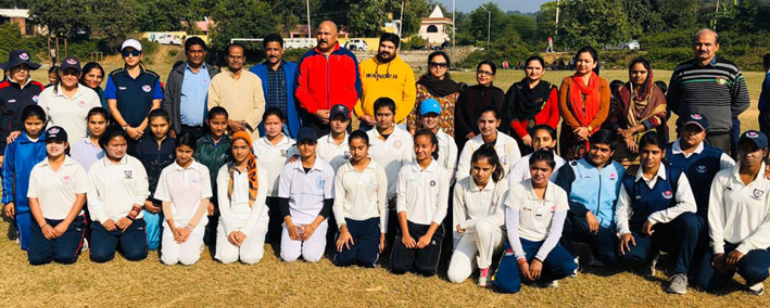 Female cricketers posing for a group photograph along with dignitaries and officials at Badhori in Samba.