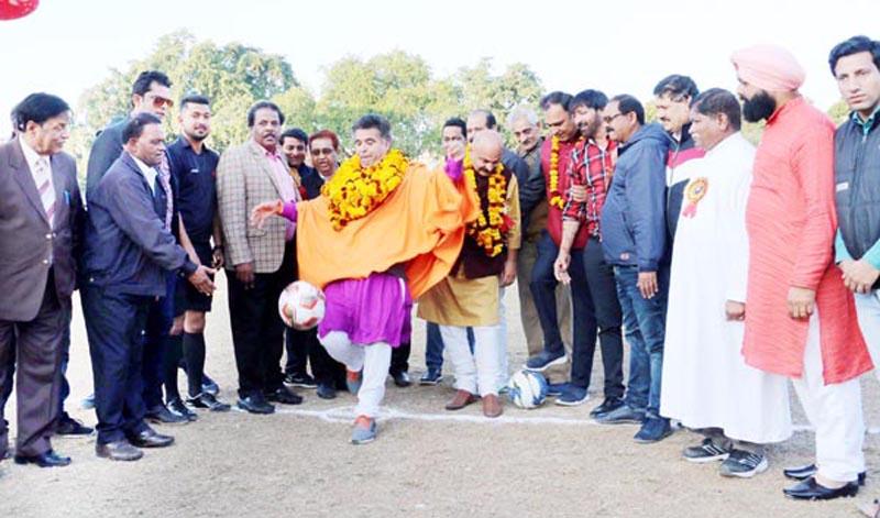 Ravinder Raina, President BJP J&K testing his soccer skills while inaugurating 13th Christmas Gold Cup in Jammu. -Excelsior/Rakesh