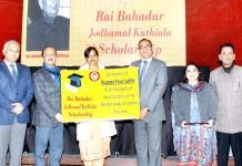 Students receiving Jodhamal Kuthiala scholarships in Jammu.