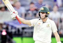 Australia's Marnus Labuschagne raising his bat after scoring 50 runs.
