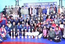 Winners of various events of Chancellor's Trophy-2019 posing along with chief guest and other dignitaries in Jammu on Saturday.