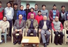 J&K Badminton team posing alongwith dignitaries and officials before leave for nationals on Friday.