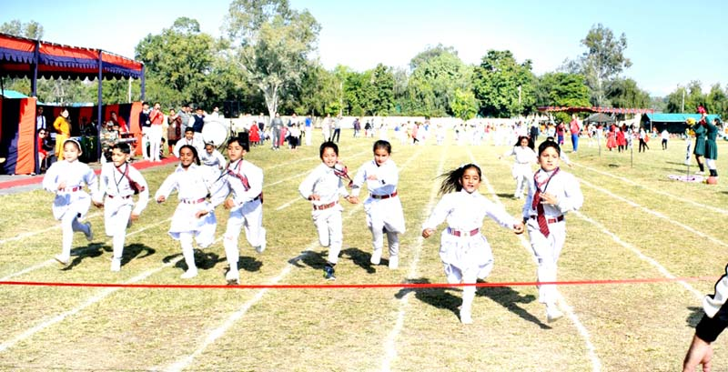 Children sweating-it-out during Annual Sports Day celebration at APS Rakhmuthi in Jammu.