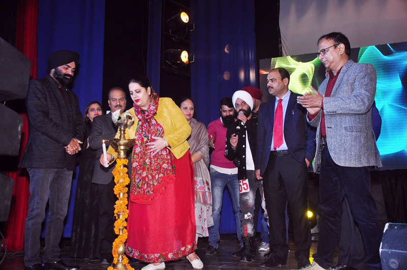 Dignitaries lighting cermonial lamp during awwareness programme on child Labour.