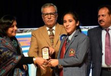 Advisor to LG, Farooq Khan honouring student during Annual DAy function of Crescent Public School at Gen Zorawar Singh Auditorium in Jammu.