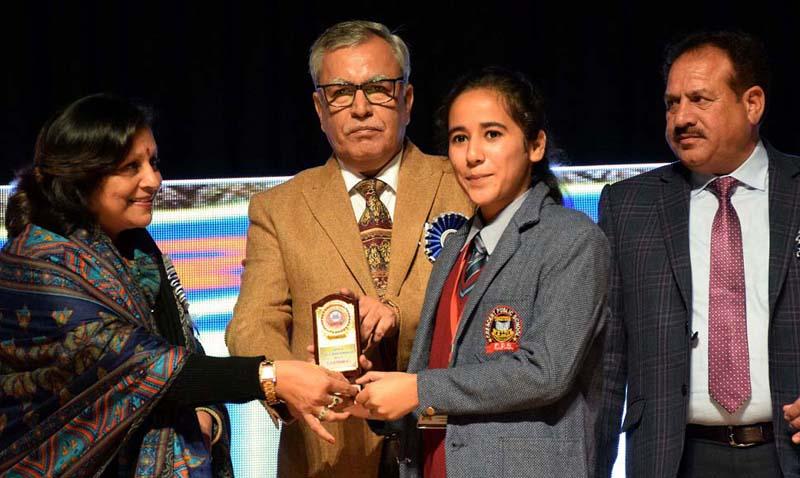 Advisor to LG, Farooq Khan honouring student during Annual DAy function of Crescent Public School at Gen Zorawar Singh Auditorium in Jammu.