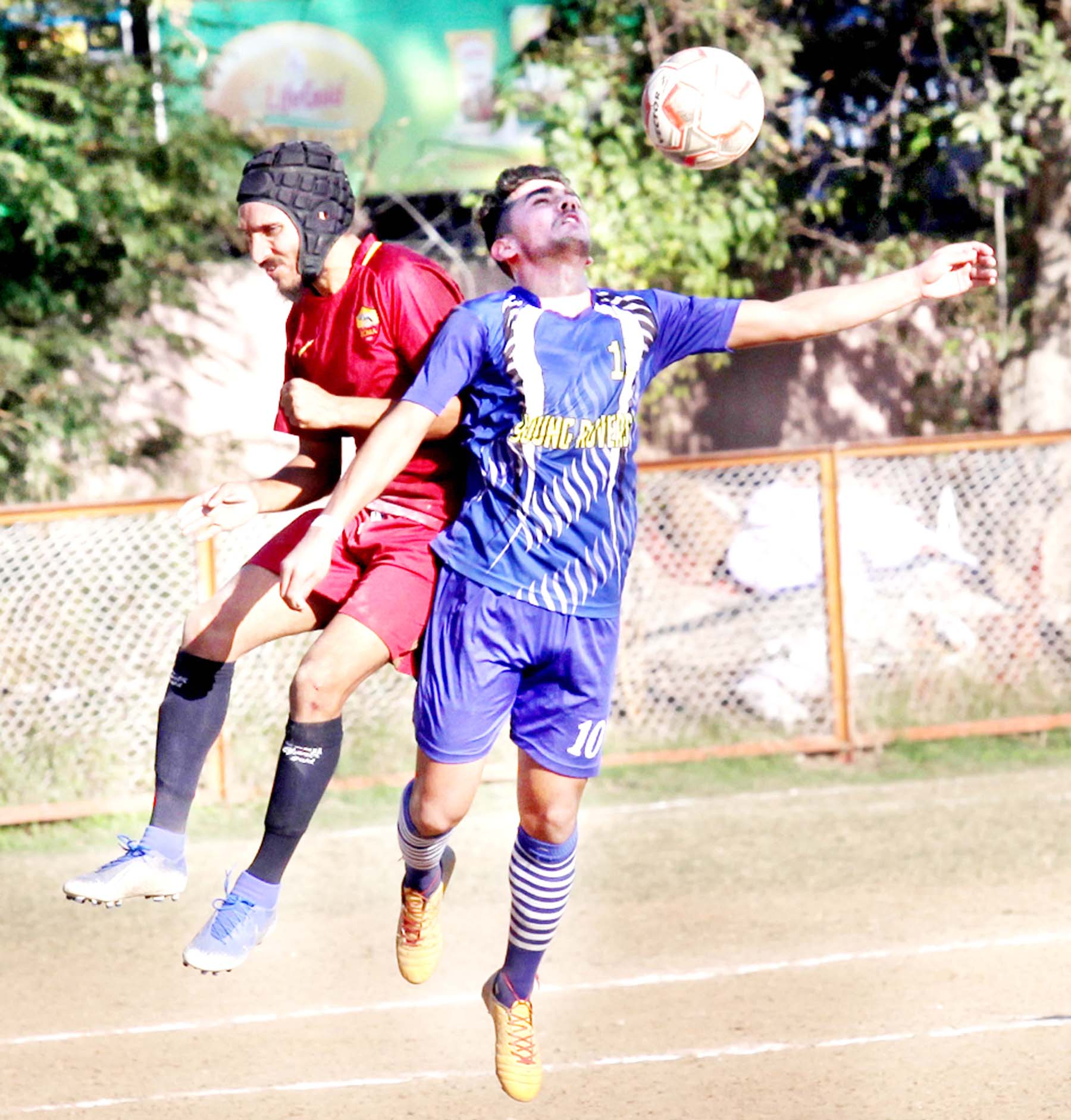 Footballer trying to get hold of the ball during a match of 13th Gold Cup Football Tournament in Jammu. -Excelsior/Rakesh