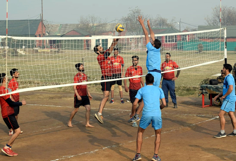 Players in action during a final match of Volleyball Tournament organised by Army in Baramulla. -Excelsior/Aabid Nabi