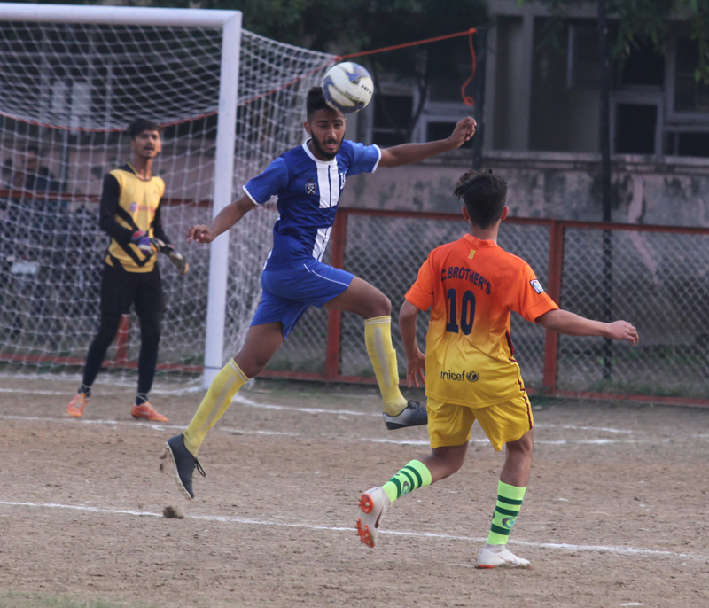 Footballers in action during 13th Gold Cup Football Tournament in Jammu.