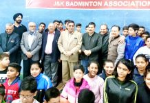 Players posing along with dignitaries and officials during inaugural ceremony of Badminton Championship.