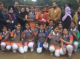 Winners of Inter-School Sports event posing for a group photograph along with the chief guest and other dignitaries at RMPS in Jammu.