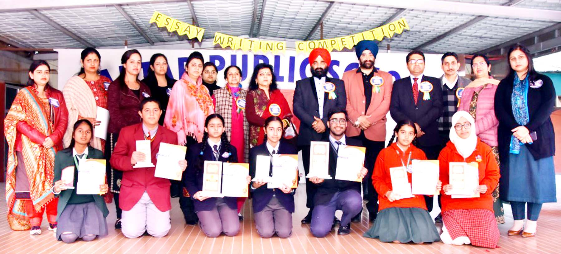 Winners of Essay Writing competition posing along with dignitaries and officials at Kartar Public School on Saturday.