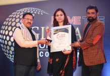 Representation of MV International School receving pretigrom award in Delhi.