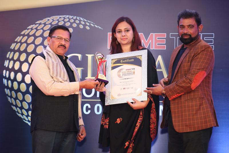 Representation of MV International School receving pretigrom award in Delhi.