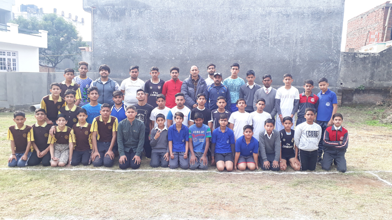 Kabaddi players posing along with chief guest at Project Model School, Janipur in Jammu.