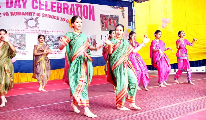 Students in colourful attires presenting cultural item while celebrating Annual Day at St Josephs Convent HS Nagrota in Jammu.