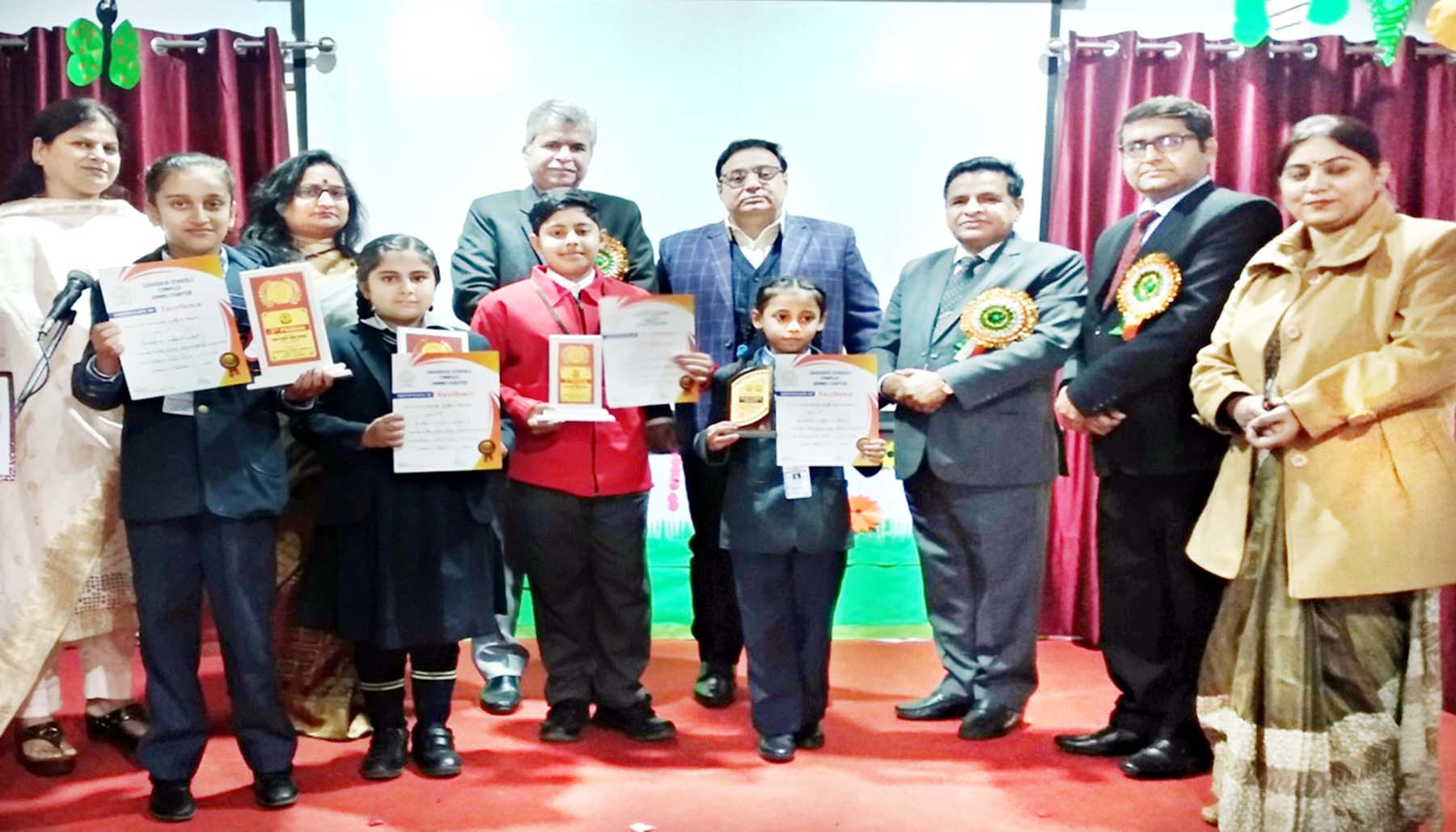 Winners of Hindi Debate posing along with chief guest and other dignitaries at Minerva Public School.
