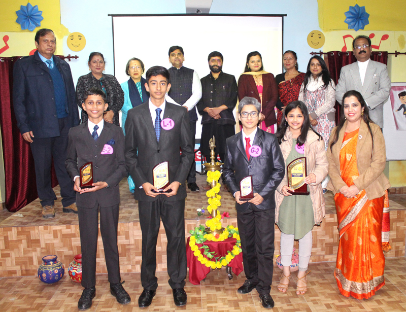 Winners of Declamation Contest posing along with dignitaries at SIPS in Jammu.