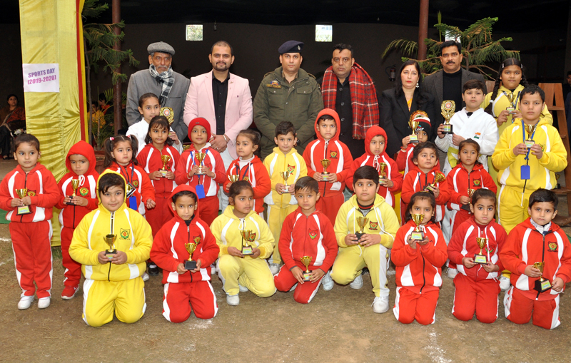 Students in colourful attires posing along with dignitaries and officials during Annual Sports Day celebration in Jammu.