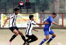 Players in action during a match of 13th Christmas Gold Cup Football Tournament in Jammu. -Excelsior/Rakesh