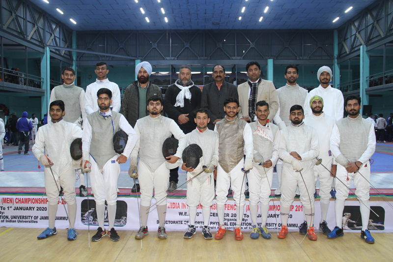 Winners posing along with dignitaries during All India Inter-University Fencing (Men) Championship at JU on Tuesday.