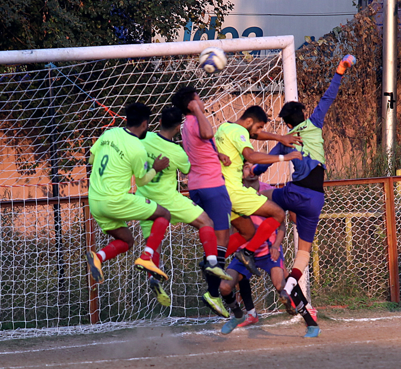 Footballers making valiant efforts to get hold of the ball during a match at GGM Science College Football ground in Jammu. -Excelsior/Rakesh