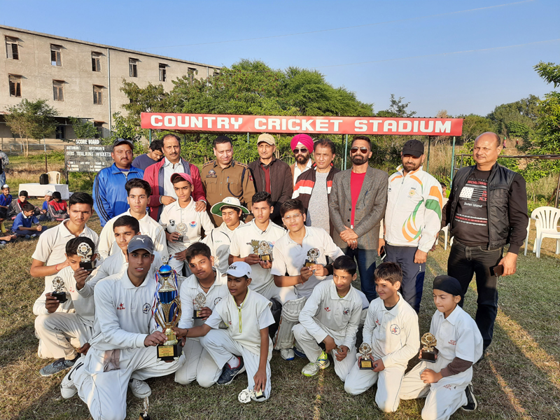 Players of Project Model HSS Jammu posing for a photograph after claiming Inter-School Cricket title at Country Cricket Stadium, Gharota in Jammu.