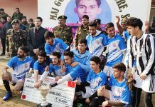 Players of Sopore FC posing for a group photograph after winning Kashmir Football Championship on Wednesday.