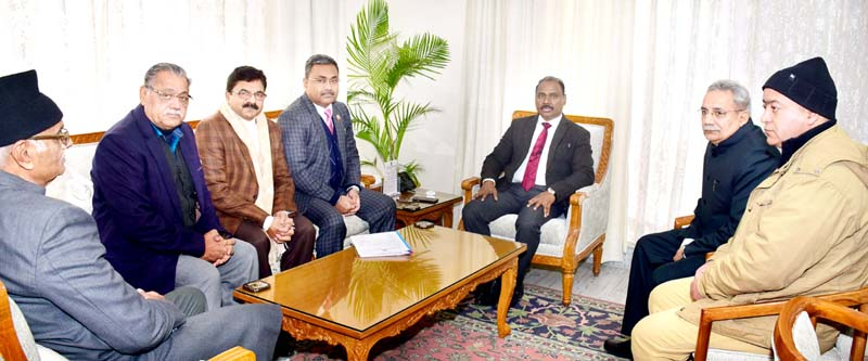 Lt Governor GC Murmu meeting joint delegation of Jammu Fruit Association and Chemists & Druggists Association in Jammu on Monday.