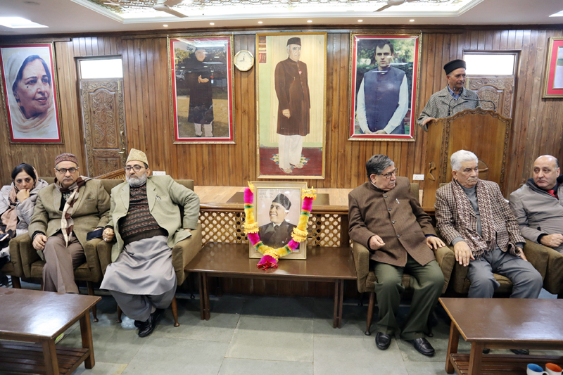 NC leaders paying tributes to Sheikh Abdullah at party office in Srinagar on Thursday. — Excelsior/Shakeel