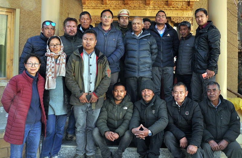 LG R K Mathur with officers and locals during visit to Model Village Saboo in Leh on Sunday.