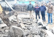 Encroachment being removed by Revenue officials in Gole area of Jammu West on Thursday.