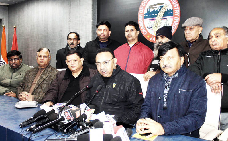 President, JCCI Rakesh Gupta , flanked by other office bearers, addressing press conference in Jammu on Tuesday. -Excelsior/ Rakesh