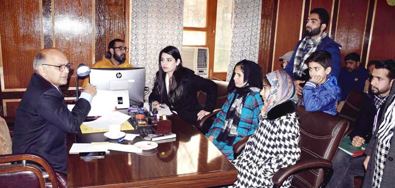 Advisor K K Sharma interacting with a delegation in Srinagar on Tuesday.