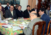 Lt Governor chairing meeting at Jammu on Saturday.
