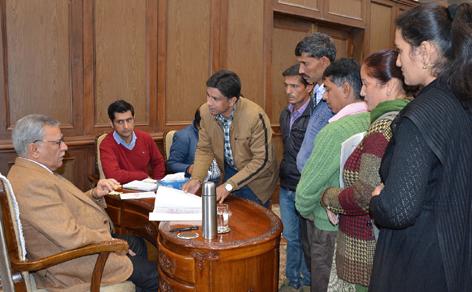 Advisor Farooq Khan interacting with a delegation.