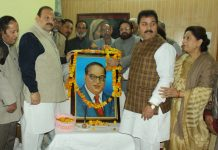 NC Provincial President Devender Singh Rana and other leaders paying tributes to Dr Ambedkar.