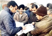 Deputy Commissioner Srinagar, Dr Shahid Iqbal Choudhary interacting with owners of land on Sunday.
