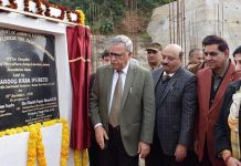Advisor Farooq Khan laying foundation stone of development works at Bagh-e-Bahu on Tuesday.