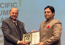 Dr Pranay Mahajan receiving award from renowned Justice (Retd) Mahavir S Chauhan at New Delhi.