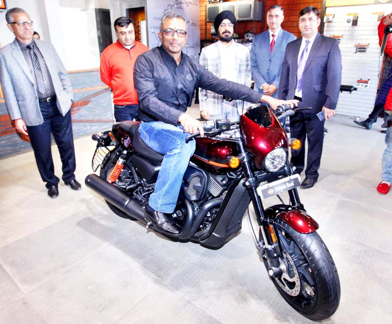 Sanjeev Rajasekharan, MD, Harley-Davidson India introducing a Harley Davidson bike during inauguration of Ridges Harley-Davidson dealership at Jammu on Sunday. -Excelsior/Rakesh