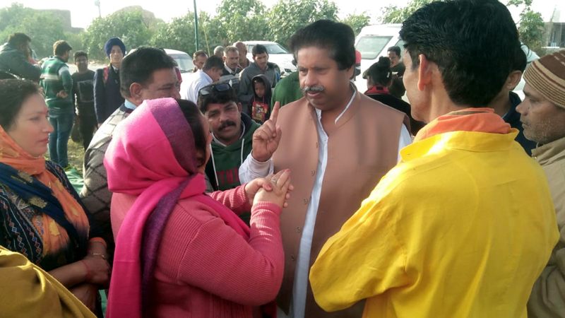 Congress leader Raman Bhalla interacting with people at Beli Charana in Jammu on Tuesday.
