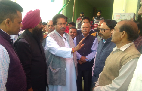 Cong leader Raman Bhalla interacting with people in Gandhi Nagar on Monday.