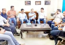 SKUAST-TAJ executive body members holding meeting.