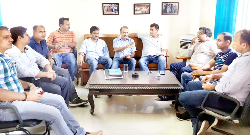 SKUAST-TAJ executive body members holding meeting.