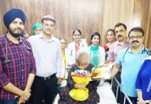 Dr Rajeev Gupta and his team posing with the patient on whom they conducted Bone Marrow Transplant.