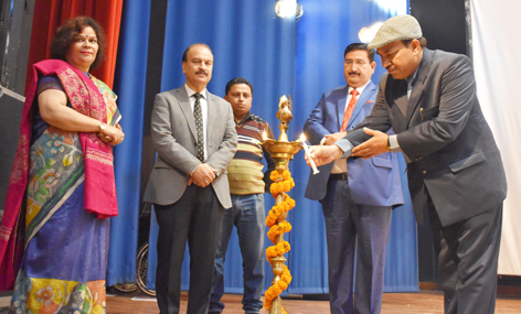 Guests lighting ceremonial lamp during 'Sham-e-Gazal' by AIR Jammu.